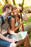 Hikers backpackers couple reading map on trip. Royalty Free Stock Image