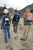 Hikers With Backpacks Hiking Stock Photo