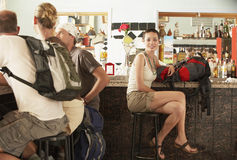 Hikers With Backpacks Sitting In Bar Royalty Free Stock Photos