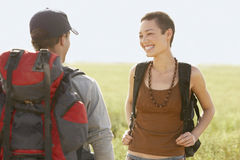 Hikers With Backpacks Standing In Field Royalty Free Stock Image
