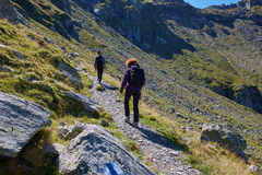 Hikers with backpacks on trail Stock Photography