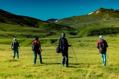 Hikers with backpacks and trekking poles walking in Artvin highland. Hikers with backpacks and trekking es walking in Turkish highland stock images