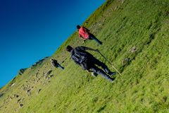 Hikers with backpacks and trekking poles walking in Artvin highland. Hikers with backpacks and trekking es walking in Turkish highland royalty free stock photos