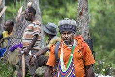 Hikers in Baliem Valley. Baliem Valley, West Papua, Indonesia, February 12th, 2016: Hikers in Baliem Valley royalty free stock images