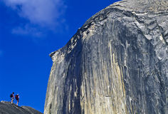 Hikers below Half Dome. Royalty Free Stock Images