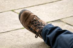 Hikers boot on paving stone with copy space royalty free stock photos