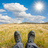 Hikers boots on mountains meadow Stock Photography