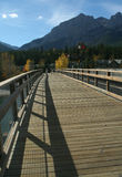 Hikers on bridge over Bow River. Canadian Rockies,Kananaskis,Canmore, Banff,Alberta, Canada Royalty Free Stock Photos
