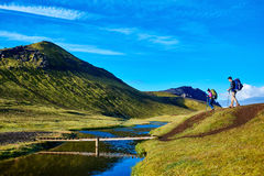 Hikers and bridge over creek, trekking in Iceland Royalty Free Stock Photography