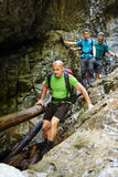Hikers in a canyon Stock Photos