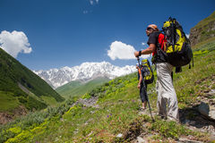 Hikers in Caucasus mountains Stock Images