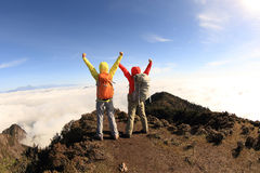Hikers cheering to sunrise on mountain peak Royalty Free Stock Photography