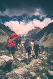Hikers climb to the mountain. Instagram stylisation royalty free stock image