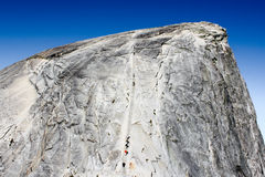 Hikers climb to the top of Half Dome Royalty Free Stock Photos
