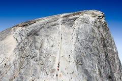 Hikers climb to the top of Half Dome. Hiker climb to top of Half Dome peak in the Yosemite National Park, California, USA Royalty Free Stock Photos
