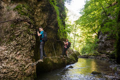 Hikers climbing above the river Royalty Free Stock Photography