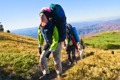 Hikers climbing the mountain. Group of hikers climbing up the rocky mountain Royalty Free Stock Images