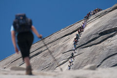 Hikers climbing on a rock Royalty Free Stock Photography