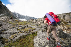 Hikers are climbing rocky slope of mountain. In Altai mountains Royalty Free Stock Photo