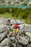 Hikers are climbing rocky slope of mountain in Altai mountains,. Hikers are climbing rocky slope of mountain in Altai mountains. Russia Royalty Free Stock Photography