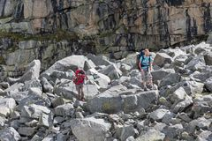 Hikers are climbing rocky slope of mountain in Altai mountains,. Russia Stock Image