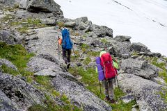 Hikers are climbing rocky slope of mountain in Altai mountains,. Russia Royalty Free Stock Photos