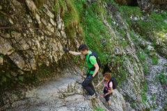 Hikers climbing on a safety cable Royalty Free Stock Photo