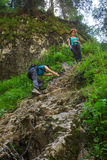 Hikers climbing on a safety chain Royalty Free Stock Image