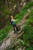 Hikers climbing on a safety chain Royalty Free Stock Photos