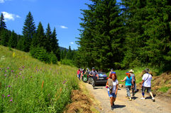 Hikers climbing up mountain trail Stock Photography