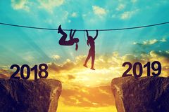 Hikers climbs into the New Year 2019. stock photo