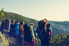 Hikers, company of friends are standing on a rocky path Stock Photo