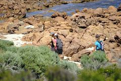 Hikers completeing the first leg of the Cape to Cape hike. royalty free stock photo