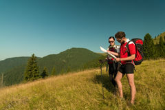 Hikers consulting the map Royalty Free Stock Photo