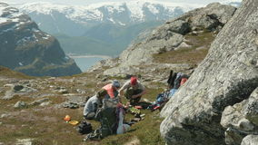 Hikers cook food in the mountains. Of Norway nearby Trolltunga stock footage