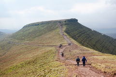 Hikers on Corn Du, Brecon Beacons National Park, South Wales. BRECON BEACONS, WALES, 27 FEB 2016.  Editorial Photograph of Hikers at Summit of Corn Du in the Stock Images