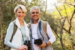 Hikers couple enjoying outdoor. Happy hikers couple enjoying outdoor activity Royalty Free Stock Image