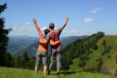Hikers couple a mountain pass Stock Photography