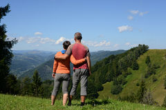 Hikers couple a mountain pass Stock Photos