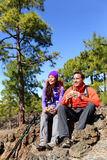 Hikers couple relaxing eating lunch hiking Stock Images