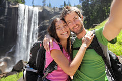 Hikers couple taking selfie at Yosemite waterfall Stock Photo