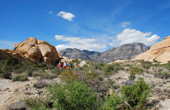 Hikers descending Turtlehead Peak in Red Rock Canyon, NV. Image shows hikers descending the lower elevations of Turtlehead Peak in Red Rock Canyon National Stock Photography