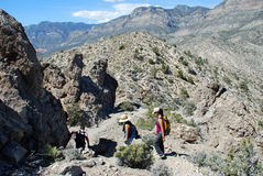 Hikers descending Turtlehead Peak in Red Rock Canyon, NV Stock Photo