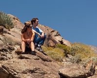 Hikers in desert look at distant object royalty free stock image