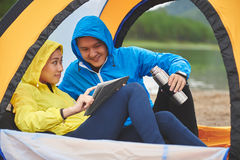 Hikers with digital tablet Stock Image