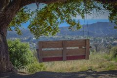Hikers Dream - the swinging bench overlooking the Pacific ocean royalty free stock photography