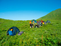Hikers eat breakfast at the camp Stock Photos