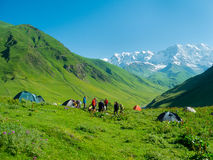 Hikers eat breakfast at the camp. In the mountains, Svaneti, Georgia Stock Photo