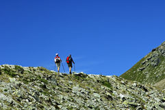 Hikers on the edge Stock Photography