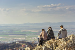 Hikers enjoying the city panorama Royalty Free Stock Photo